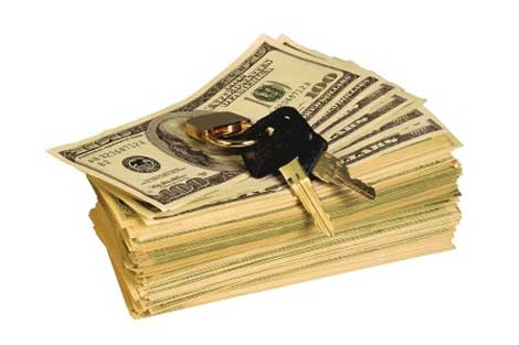 car keys on a stack of one hundred dollar bills